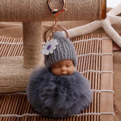 Alvó babás alakú pompom kulcstartó szürke